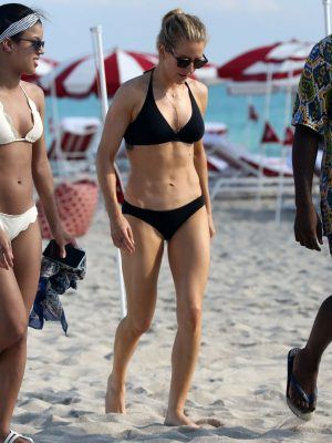 Ellie Goulding in Black Bikini on the Beach in Miami
