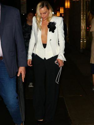 Margot Robbie Cleavage Leaving The Polo Bar in New York