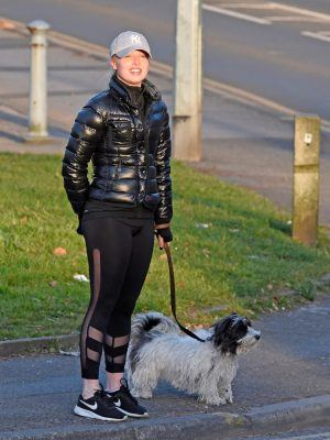 Jorgie Porter Jogging with her Dog in Manchester
