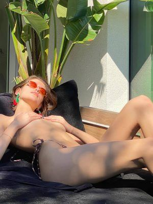 Kaia Gerber Covered Sunbathing at a Pool