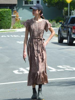 EXCLUSIVE: Margaret Qualley takes a break from quarantine to go for a walk in a floral print dress