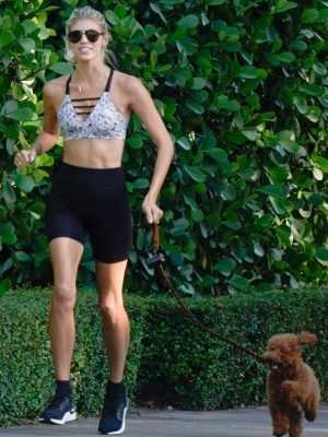 Devon Windsor Jogging with her Dog in Miami