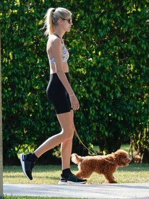 EXCLUSIVE: Victoria's Secret model Devon Windsor and husband Johnny Barbara go jogging while walking their dog in Miami