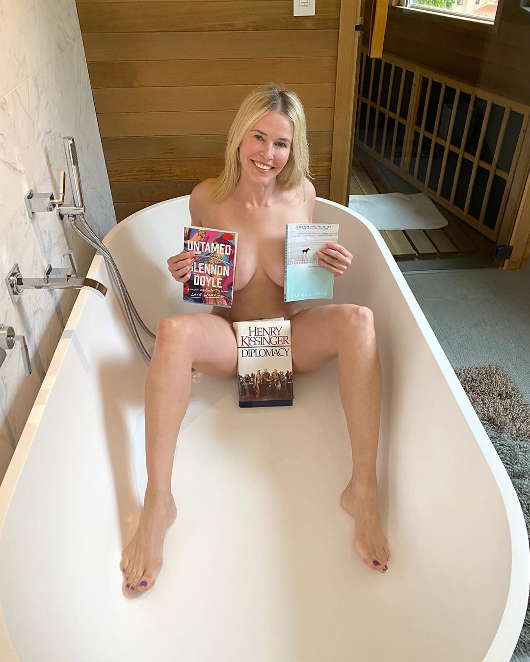 Chelsea Handler Photographed Topless MILF body with some Books – Instagram April 2020