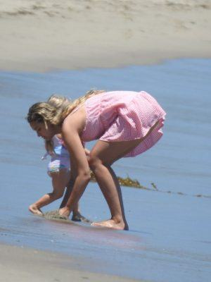 April Love Geary with kids on the Beach in Malibu
