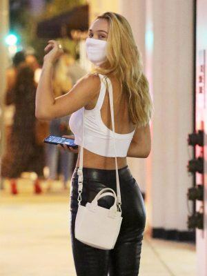 Alexis Ren Booty in Pants and in White Crop Top at Catch in Los Angeles