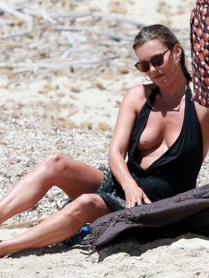 Kate Moss Braless on the Beach in Formentera