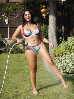 Malin Andersson Playing with Water in Bikini to Enjoy One of the Hottest Days