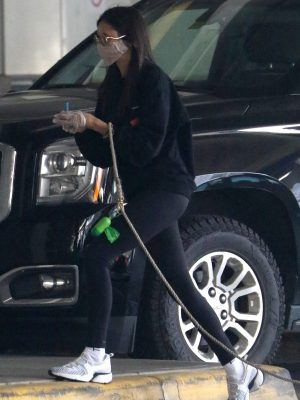 Nina Dobrev in Tights Arrive at Vancouver Airport