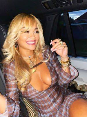 Rita Ora Shows Cleavage and Leggy inside a Car