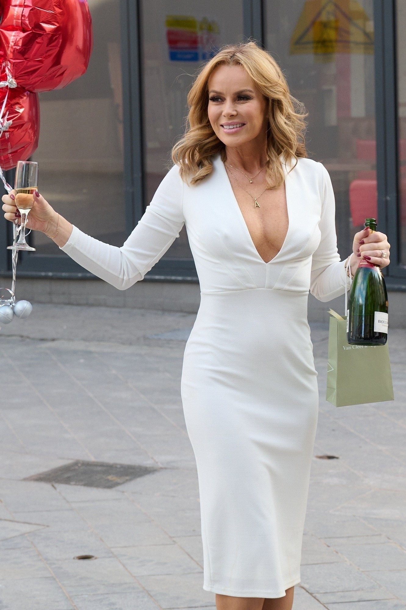 Amanda Holden with Hearts and Cleavage Leaving Global Studios in London